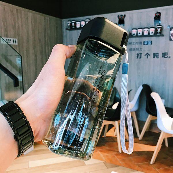 Botella de agua de plástico cuadrada botella transparente portátil zumo de fruta a prueba de fugas deporte al aire libre botella de Camping taza de la escuela